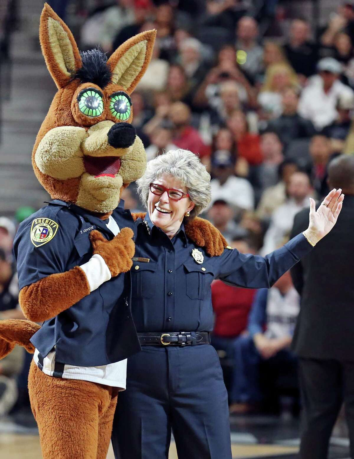The San Antonio Spurs Coyote performs with Sheriff Susan Pamerleau during a timeout in the game with the Dallas Mavericks Sunday Jan. 17, 2016 at the AT&T Center.