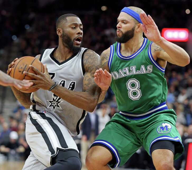 San Antonio Spurs' Jonathon Simmons looks for room around Dallas Mavericks' Deron Williams during second half action Sunday Jan. 17, 2016 at the AT&T Center. The Spurs won 112-83.
