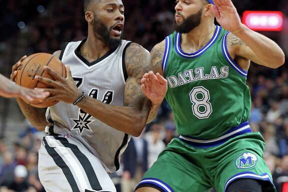 San Antonio Spurs' Jonathon Simmons looks for room around Dallas Mavericks' Deron Williams during second half action Sunday Jan. 17, 2016 at the AT&T Center. The Spurs won 112-83.