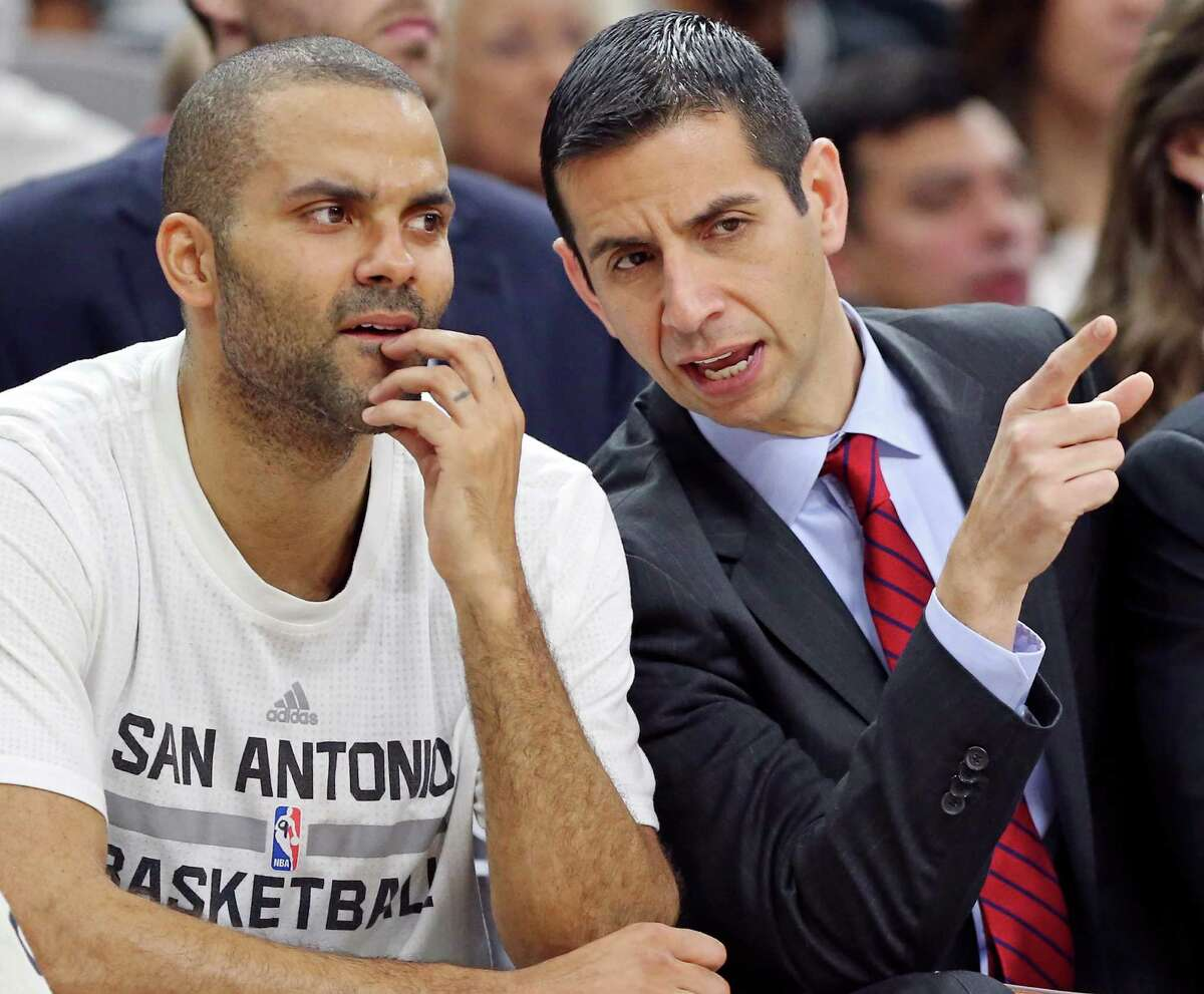 San Antonio Spurs' Tony Parker talks with assistant coach James Borrego during first half action against the Dallas Mavericks Sunday Jan. 17, 2016 at the AT&T Center.