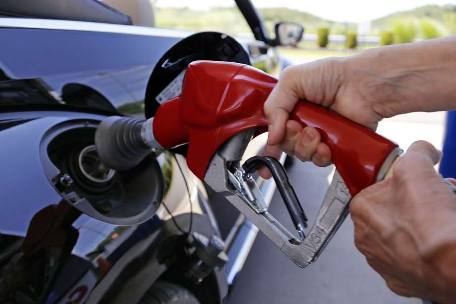 Tight gasoline supplies and more expensive summer fuel blends continue to push prices up at the pump.  NEXT: See gasoline prices in Texas' biggest cities. Photo: Gene J. Puskar, Associated Press