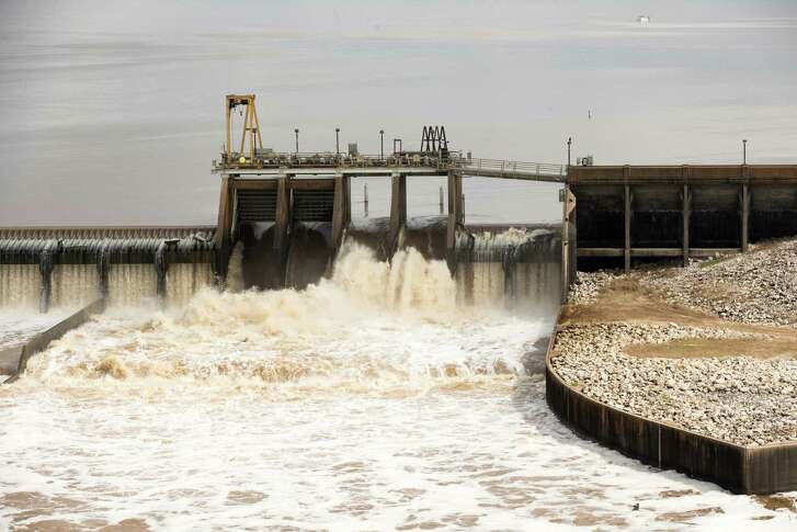 Water flows from the spillway from Lake Houston into the San Jacinto River on Saturday, May 30, 2015, in Houston. (Brett Coomer / Houston Chronicle )