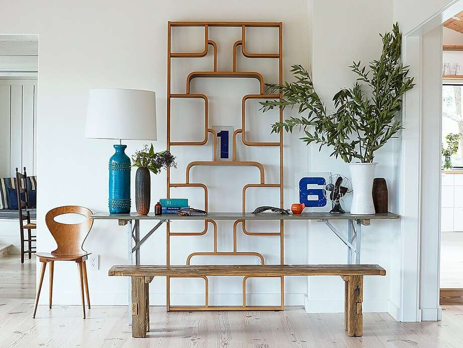 Sonoma farmhouse: Allison Bloom updated with an antique Thonet étagère displaying numbers from a gas station, a simple table and plank bench.  Photo: John Merkl