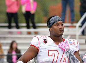 New Canaan's Lucas Niang (74) has committed to play football at TCU.