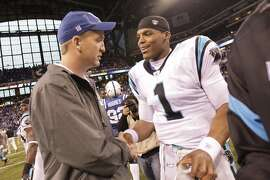FILE - In this Nov. 27, 2011, file photo, injured Indianapolis Colts quarterback Peyton Manning meets with Carolina Panthers quarterback Cam Newton after an NFL football game in Indianapolis. For the next two weeks, until Peyton Manning's AFC champion Denver Broncos face Cam Newton's NFC champion Carolina Panthers in the 50th Super Bowl in Santa Clara, California, most of the focus will be on the two quarterbacks who were No. 1 overall draft picks 13 years apart. (AP Photo/AJ Mast, File)