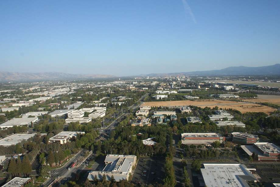 North First Street, center of photo, is a main artery from downtown San Jose to the northern city, and includes light rail access. San Jose Mineta International Airport is seen on the right. Part of the open field, center, is part of the land Apple purchased in North San Jose. Photo: City Of San Jose