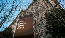 FILE - This April 13, 2014, file photo, shows The Internal Revenue Service (IRS) headquarters building Washington. Although many small business owners hire accountants and attorneys to complete their income tax returns, taxes are a hassle. In a survey released in 2015 by the advocacy group National Small Business Association, nearly 60 percent of the owners surveyed said the administrative burdens were the biggest problems posed by federal taxes. And 85 percent of the more than 675 owners said they relied on a professional to prepare their returns. (AP Photo/J. David Ake, File)