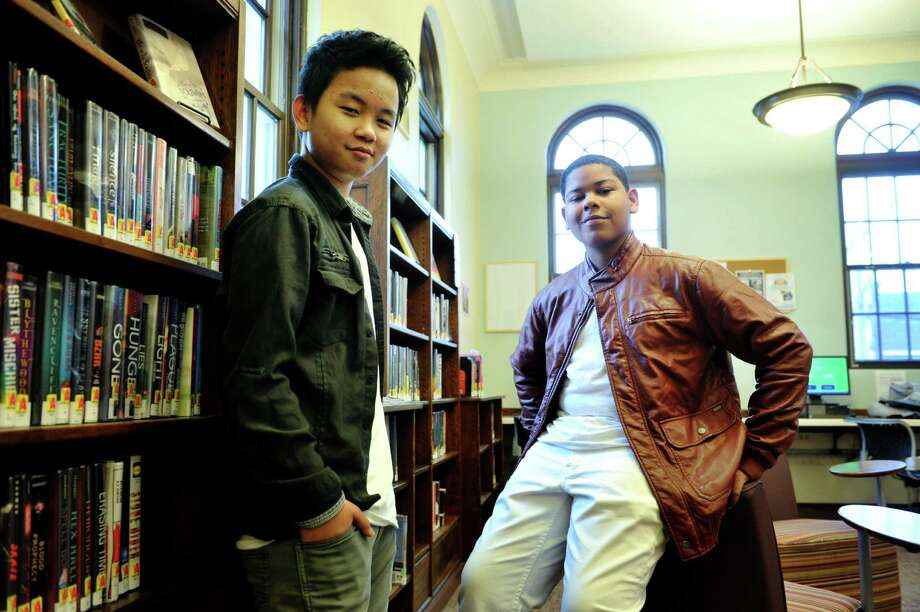 "Song writers Lee Reh, left, and Rah-mene McDuffie pose for a photo at the Albany Public Library John Howe Branch on Monday, Jan. 25, 2016, in Albany, N.Y.  The two wrote the song ""Fight,"" about resisting drugs and the violence of the streets.  They are the winners of the sixth annual GRAMMY Foundation and MusiCares Teens Make Music Contest.  (Paul Buckowski / Times Union) Photo: PAUL BUCKOWSKI / 10035147A"