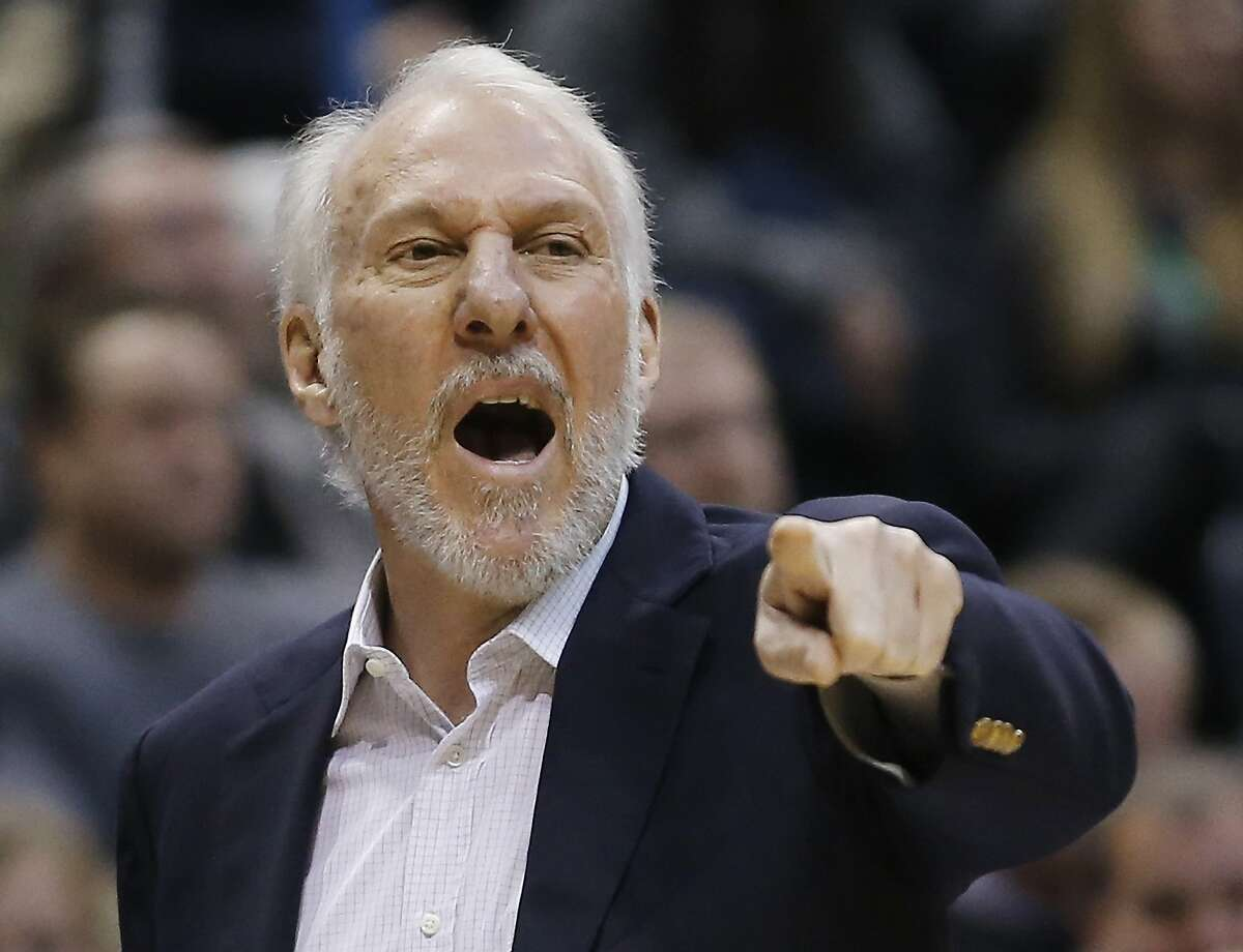FILE - In this Jan. 4, 2016, file photo, San Antonio Spurs coach Gregg Popovich reacts to a call during the first half of the team's NBA basketball game against the Milwaukee Bucks in Milwaukee. It's rare in the NBA for two teams to be winning at the pace the Golden State Warriors and the SSpurs are setting, especially at the same time. The teams meet for the first time this season on Monday, Jan. 25, in what seems like a Western Conference preview. (AP Photo/Morry Gash, file)