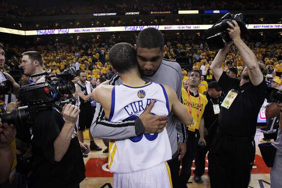 Stephen Curry (30) hugs Tim Duncan after the Warriors lost to the Spurs 94-82. The Golden State Warriors played the San Antonio Spurs in Game 6 of the Western Conference Semifinals at Oracle Arena in Oakland, Calif., on Thursday, May 16, 2013.