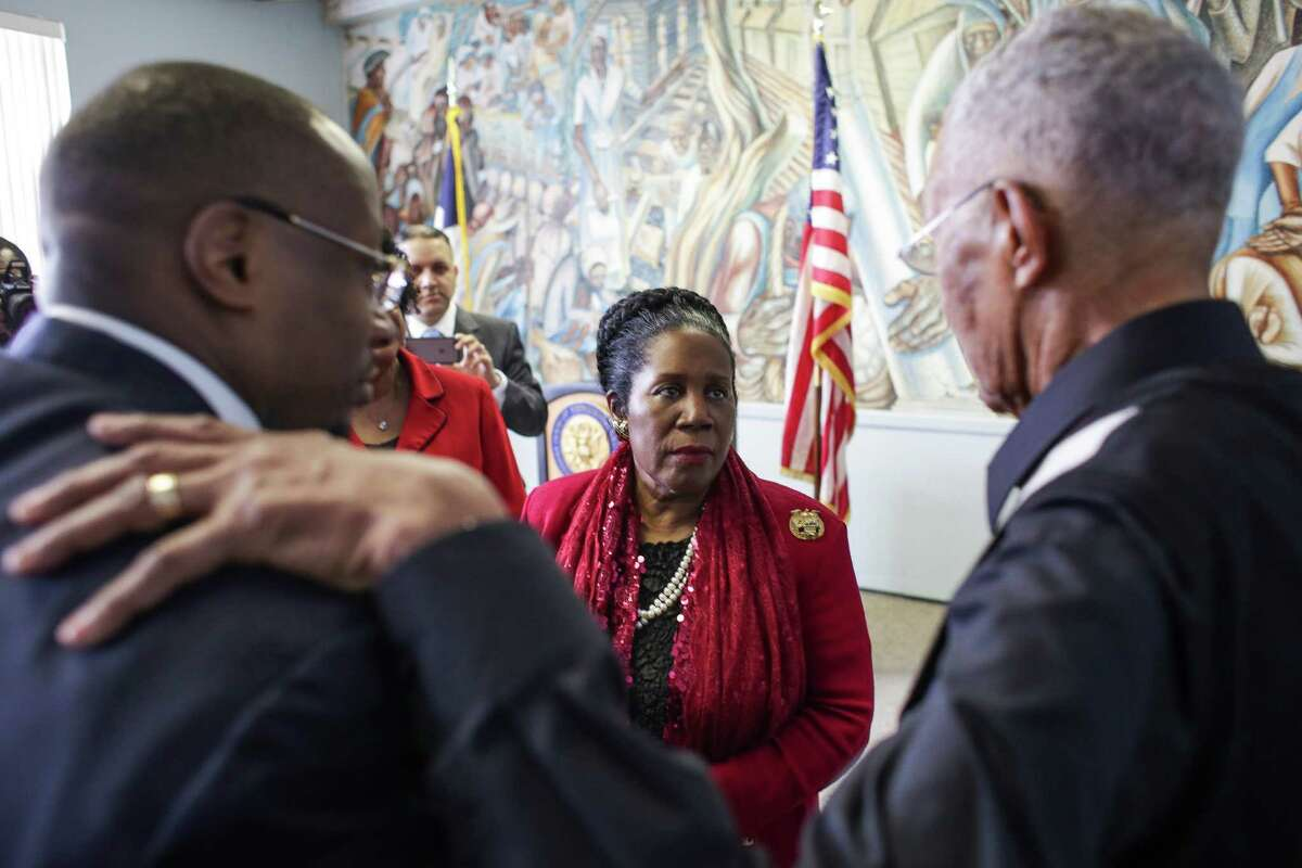 Congresswoman Sheila Jackson Lee, center, said she is seeking federal funds to help improve the Blue Triangle Community Center, where she spoke with The Revs. Marcus D. Cosby, left, and William A. Lawson, on Monday.