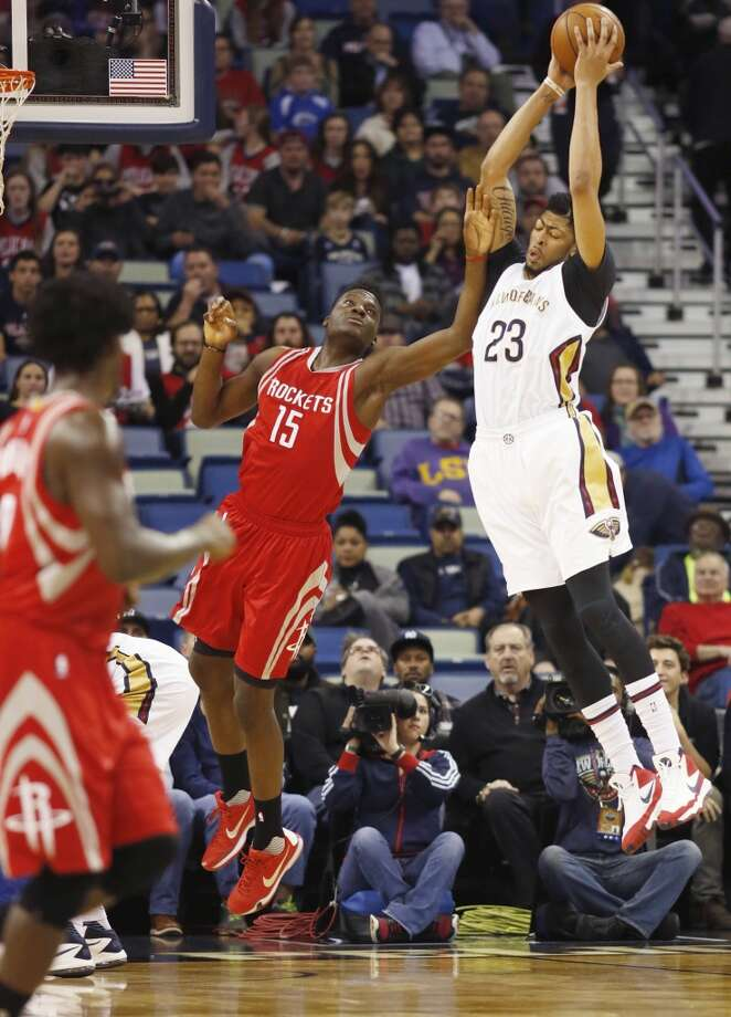 New Orleans Pelicans forward Anthony Davis (23) captures a rebound against Houston Rockets forward Clint Capela in the first half of an NBA basketball game in New Orleans, Monday, Jan. 25, 2016. (AP Photo/Max Becherer) Photo: Max Becherer, Associated Press