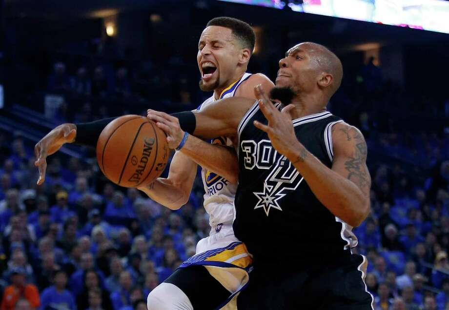 OAKLAND, CA - JANUARY 25:  Stephen Curry #30 of the Golden State Warriors is fouled by David West #30 of the San Antonio Spurs at ORACLE Arena on January 25, 2016 in Oakland, California. NOTE TO USER: User expressly acknowledges and agrees that, by downloading and or using this photograph, User is consenting to the terms and conditions of the Getty Images License Agreement. Photo: Ezra Shaw, Getty Images / 2016 Getty Images