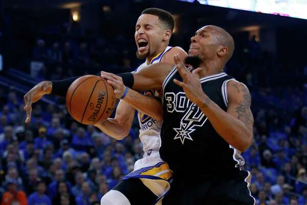OAKLAND, CA - JANUARY 25:  Stephen Curry #30 of the Golden State Warriors is fouled by David West #30 of the San Antonio Spurs at ORACLE Arena on January 25, 2016 in Oakland, California. NOTE TO USER: User expressly acknowledges and agrees that, by downloading and or using this photograph, User is consenting to the terms and conditions of the Getty Images License Agreement.