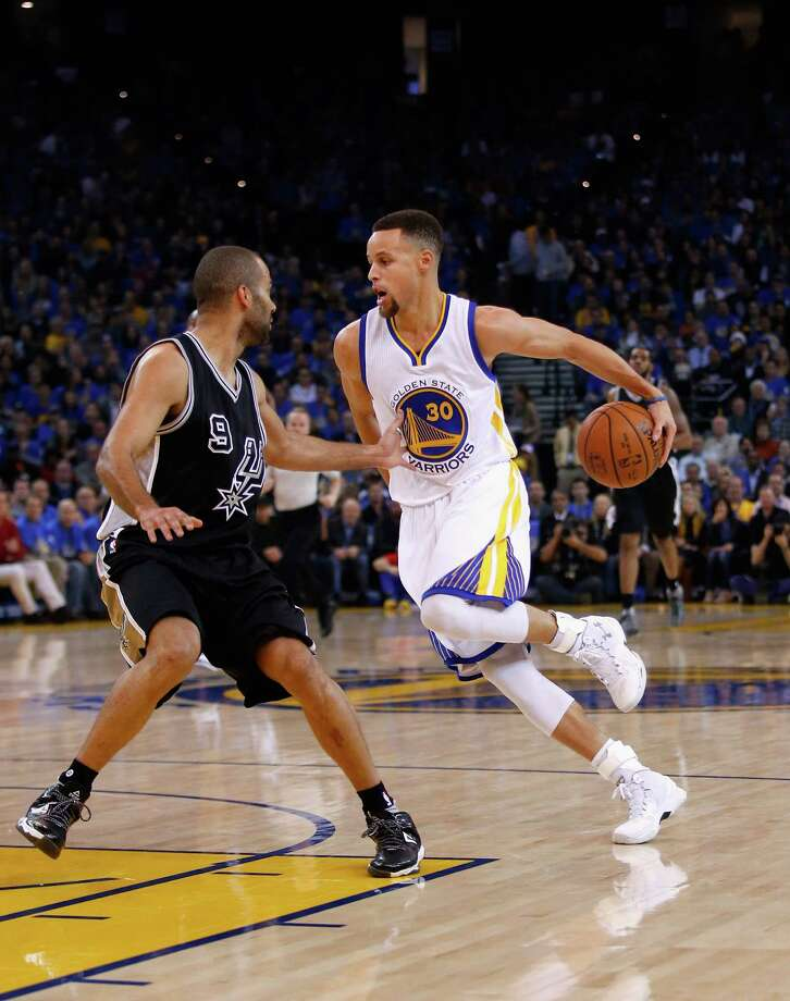OAKLAND, CA - JANUARY 25:  Stephen Curry #30 of the Golden State Warriors dribbles around his back while covered by Tony Parker #9 of the San Antonio Spurs at ORACLE Arena on January 25, 2016 in Oakland, California. NOTE TO USER: User expressly acknowledges and agrees that, by downloading and or using this photograph, User is consenting to the terms and conditions of the Getty Images License Agreement. Photo: Ezra Shaw, Getty Images / 2016 Getty Images