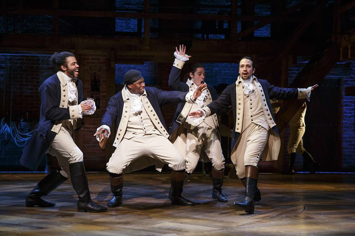 """Daveed Diggs, left, as Thomas Jefferson, Okieriete Onaodowan, Anthony Ramos and playwright-composer Lin-Manuel Miranda in the title role in """"Hamilton"""" on Broadway"""