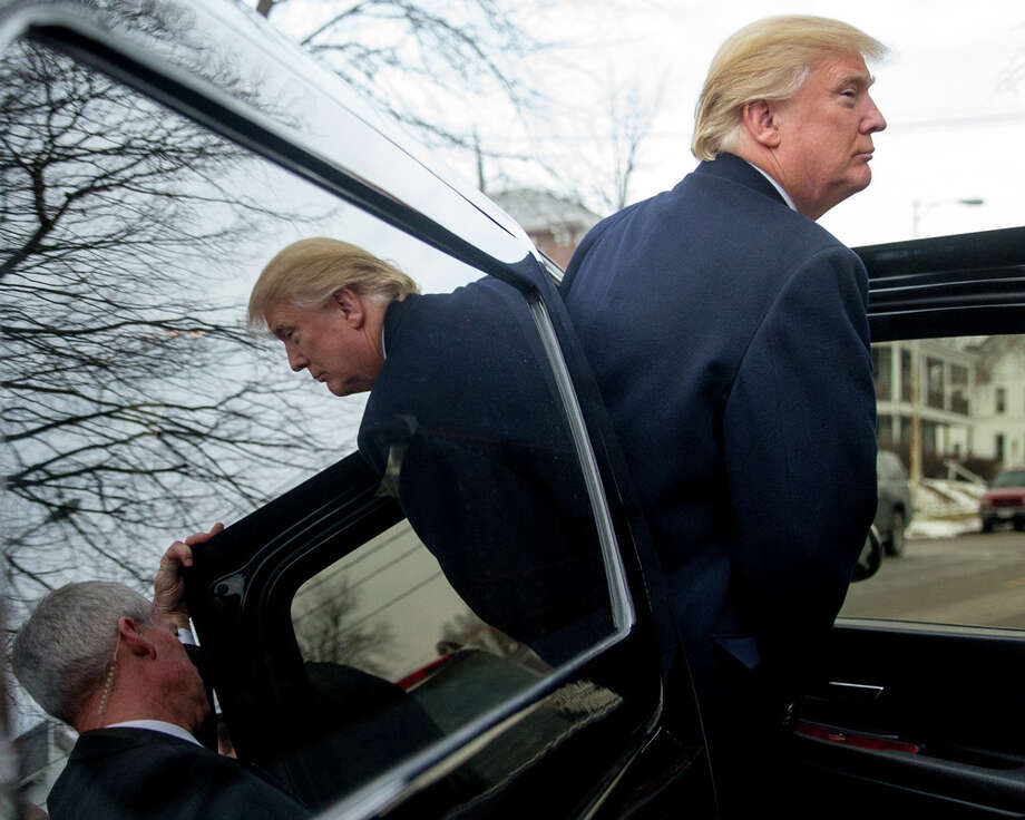 Republican presidential candidate Donald Trump departs after attending service at First Presbyterian Church in Muscatine, Iowa, Sunday, Jan. 24, 2016. Photo: Andrew Harnik / Associated Press / Associated Press