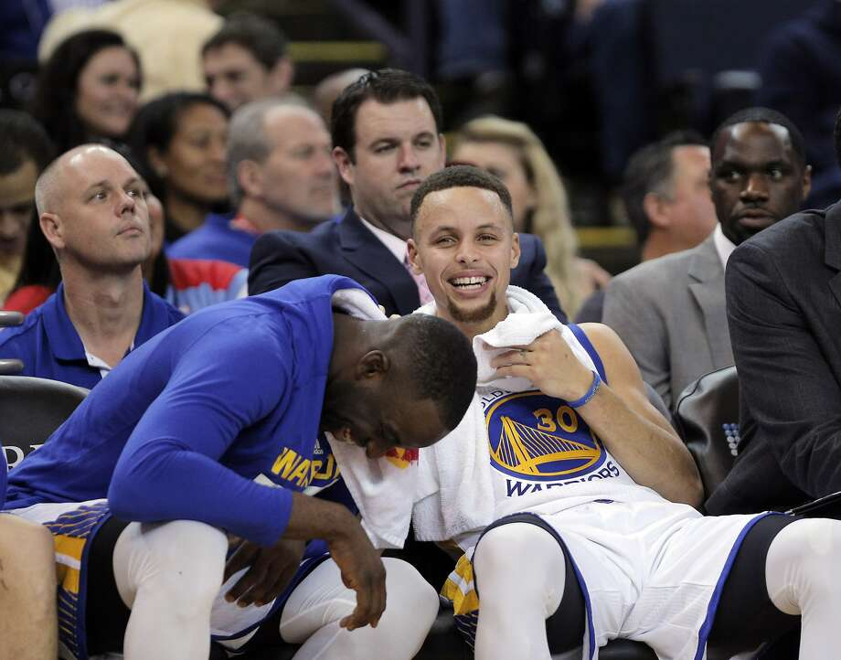 Draymond Green (23) and Stephen Curry (30) laugh on the bench  during the second half of the Golden State Warriors game against the San Antonio Spurs at Oracle Arena in Oakland, Calif., on Monday, January 25, 2016. Photo: Carlos Avila Gonzalez, The Chronicle
