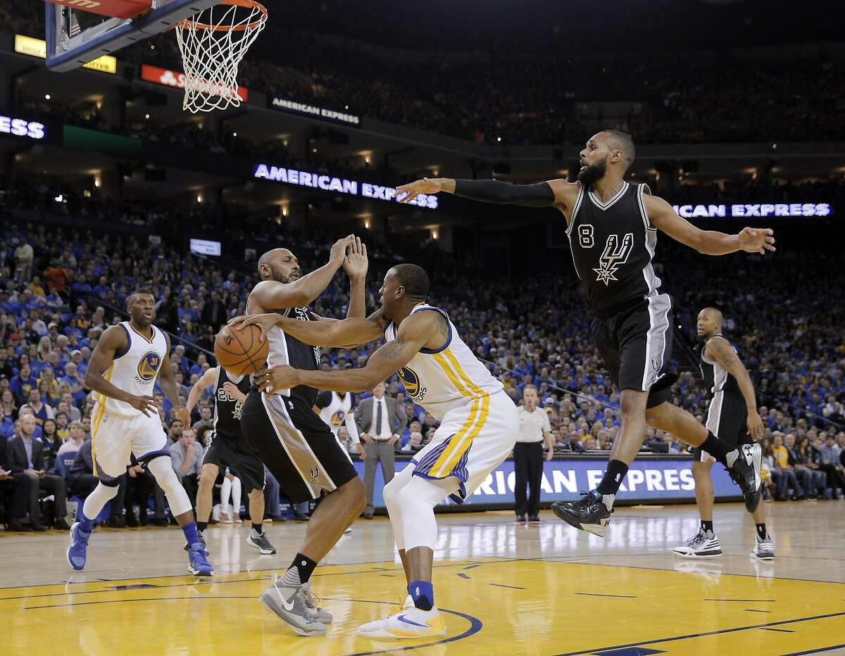Andre Iguodala (9) passes behind Boris Diaw (33) during the second half of the Golden State Warriors game against the San Antonio Spurs at Oracle Arena in Oakland, Calif., on Monday, January 25, 2016.