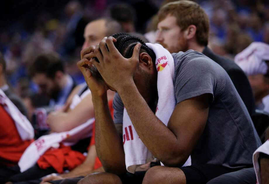 San Antonio Spurs' Kawhi Leonard put his hands over his face in the closing minutes of a 120-90 loss to the Golden State Warriors during an NBA basketball game Monday, Jan. 25, 2016, in Oakland, Calif. (AP Photo/Marcio Jose Sanchez) Photo: Marcio Jose Sanchez, Associated Press / AP