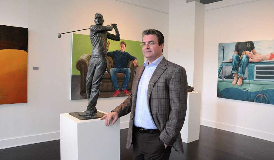 Glade Gallery owner Dragos Tapu in the new Glade Gallery, 24 Waterway Avenue, is currently exhibiting Doru Nuta, a Romanian sculptor and painter. The art gallery just opened next to Hubbell and Hudson Bistro, and is expected to bring international artists to The Woodlands. Photograph by David Hopper Photo: David Hopper, Freelance / freelance