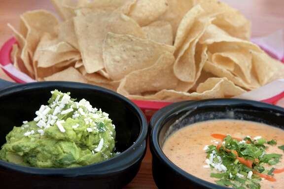Guacamole, chips and chile queso are photographed at Torchy's Tacos on Sunday, April 22, 2012 in Houston, TX.  ( J. Patric Schneider / For the Chronicle )