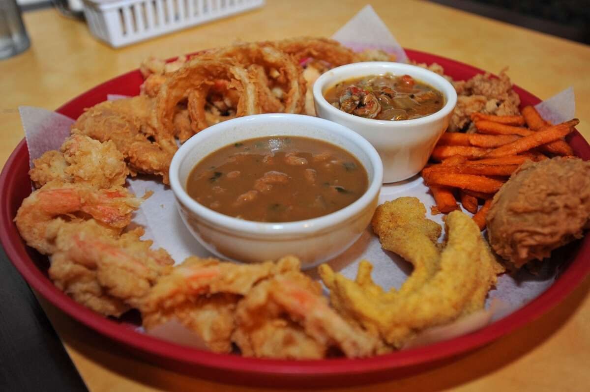 Vautrot's platter is served up with gumbo, fried frog legs, fried shrimp, fried catfish onion rings and other goodies. Vautrot's Cajun Cuisine at 13350 Hwy 105. Photo taken Tuesday, February 7, 2012 Guiseppe Barranco/The Enterprise