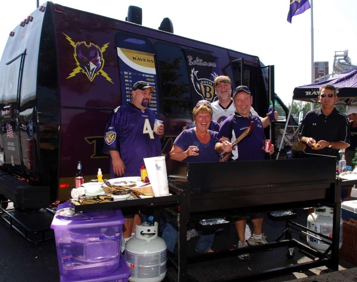 """8. Baltimore """"Whether it's from the streamers blowing in the wind, team clothing or dyed hair, a Baltimore tailgate can be spotted miles away. As Maryland is known for seafood, Baltimore fans get creative with their tailgate cuisine."""""""