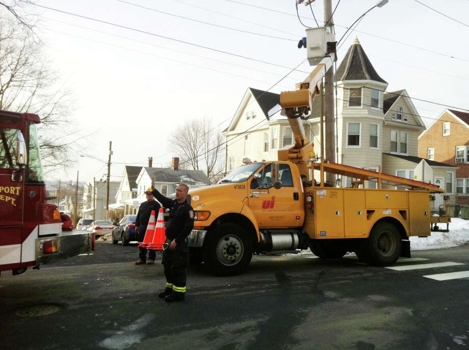 Crews on the scene near the intersection of Mead Street and Central Ave. in Bridgeport, Conn. where a school bus ran over a downed powerline on Tuesday, Jan. 26, 2016. No one was injured in the incident. Photo: Ned Gerard / Hearst Connecticut Media / Connecticut Post