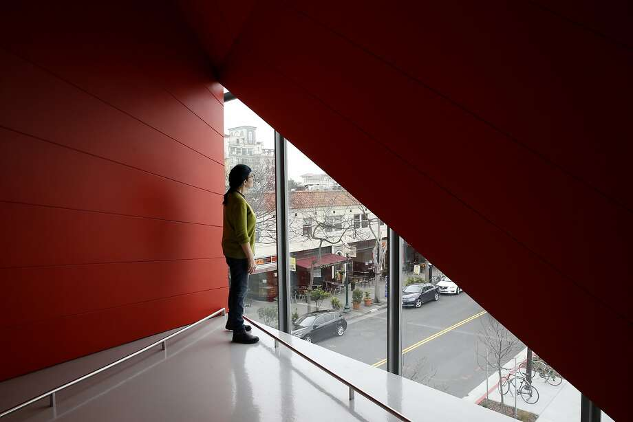 Joan Ellis, owner of Babette Cafe, takes in the view Center Street from the cafe's standing lounge at the new location of the Berkeley Art Museum and Pacific Film Archive in Berkeley, Calif. on Tuesday, Jan. 26, 2016. BAMPFA reopens to the public on Sunday. Photo: Paul Chinn, The Chronicle