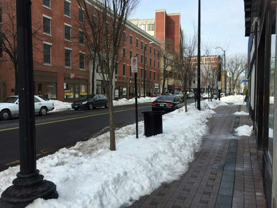 Cars are parked along Main Street in downtown Bridgeport on Tuesday. Photo: Contributed Photo