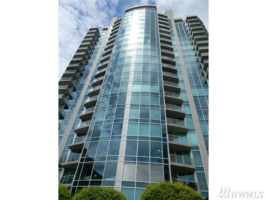 The first condo, #502 in 2000 1st Ave., is listed for $349,000. The studio condo has one bathroom and is $419 square feet. The building, One Pacific Towers, features a 24-hour concierge service. The unit itself features a private, 400 squar-foot patio. You can see the full listing here.  Photo: Courtesy Of Tim Tilbury,  Keller Williams Downtown Seattle