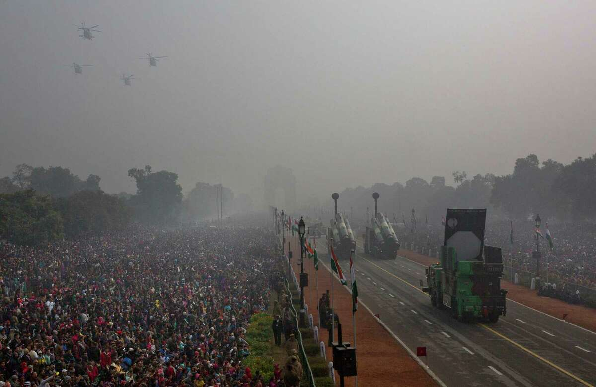 Amid hazy air, vehicles carrying Indian military hardware travel toward the India Gate on Tuesday during the Republic Day parade in New Delhi.