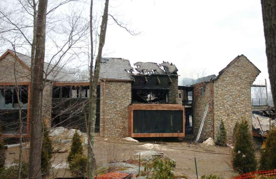 Officials could not determine the cause of the fire that destroyed the mansion at 71 North Porchuck Road in January, 2010. Photo: File Photo / Greenwich Time File Photo