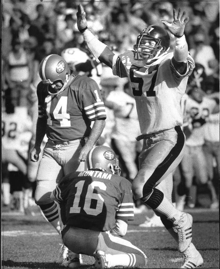 Pittsburgh Steelers player Mike Merriweather celebrates as San Francisco 49ers kicker Ray Wersching hangs his head after missing a field goal attempt that would have tied the game  Photo ran 10/15/1984, p. 45
