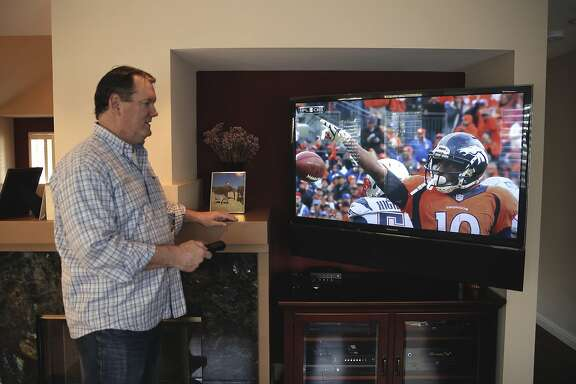 Tom near the entertainment systems in the family room of their home, in San Jose, Calif, on Tues. January 26, 2016. He and his partner Kim Lain, within a short walk to Levi's Stadium  are hoping to rent out their home to fans for Super Bowl 50.
