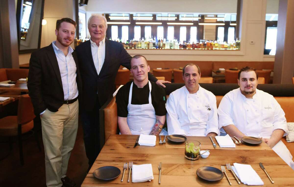 From left, owner Adam Zakka, owner Ramsey Zakka, Chef de Cuisine Matthew McNerney, owner and Executive Chef Albert DeAngelis, and Sous Chef Paul Grandetti pose in the main dining room at the new Eastend Restaurant along Greenwich Avenue in Greenwich, Conn. Tuesday, Jan. 26, 2016. Eastend, from the owners of Mediterraneo and Terra, serves American fare in small-batch offerings with a menu that changes with the season's harvest.