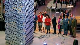 "City officials look Tuesday, Jan. 26, 2016 at the just-unveiled, $1 million ""Liquid Crystal"" art installation in the newly expanded Henry B. Gonzalez Convention Center. The installation is an interactive sculptural tower created by London-based Jason Bruges Studio."