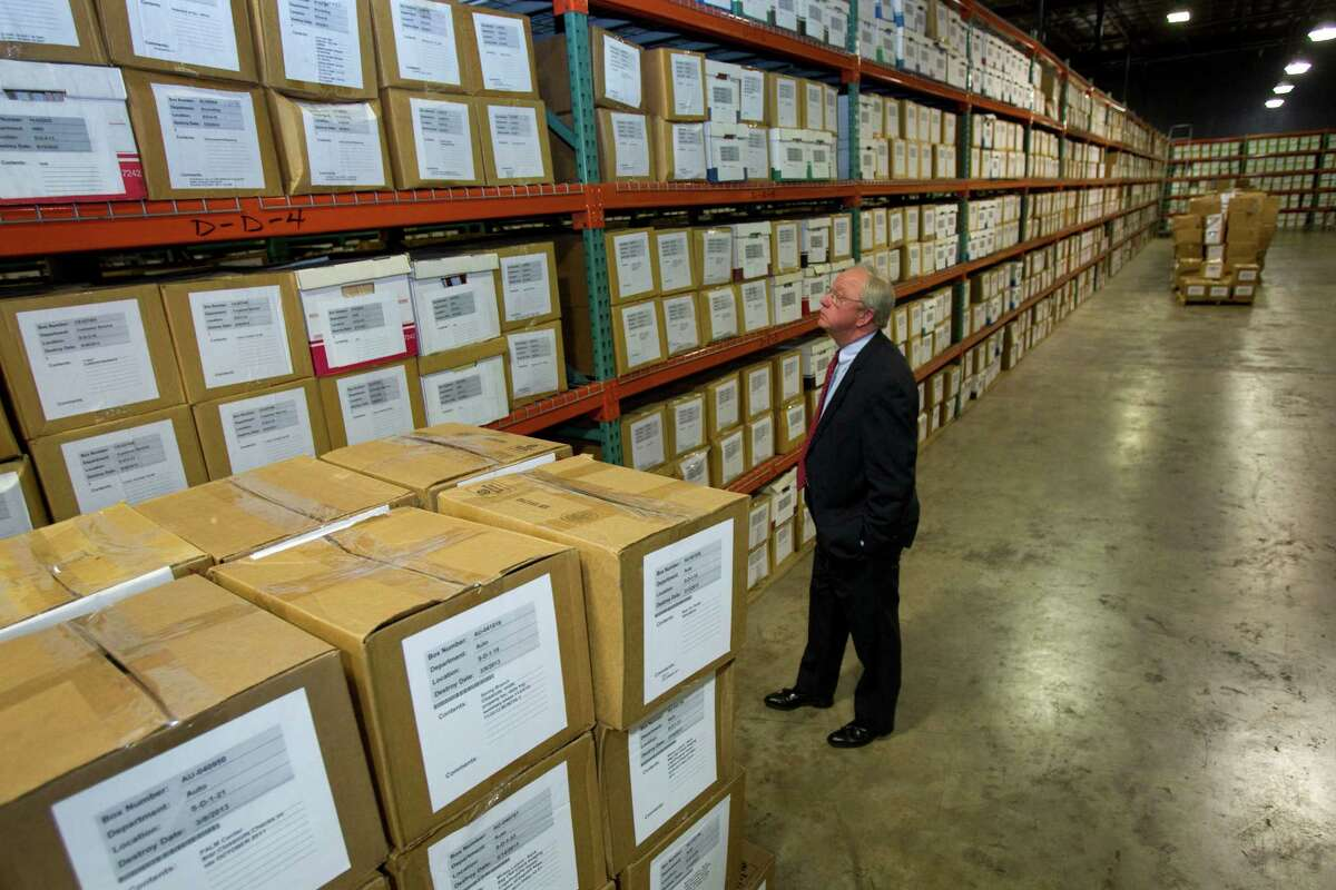 Mike Sullivan looks at stored records during an open house and tour of the new Harris County Election Technology Center Thursday, Sept. 13, 2012, in Houston. ( Brett Coomer / Houston Chronicle )