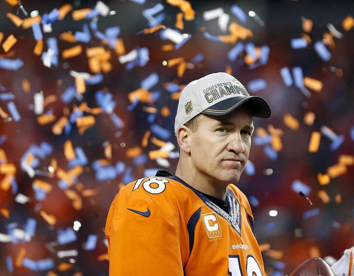 Denver Broncos quarterback Peyton Manning watches the AFC championship trophy presentation following the NFL football AFC Championship game between the Denver Broncos and the New England Patriots, Sunday, Jan. 24, 2016, in Denver. The Broncos defeated the Patriots 20-18 to advance to the Super Bowl. (AP Photo/Joe Mahoney)