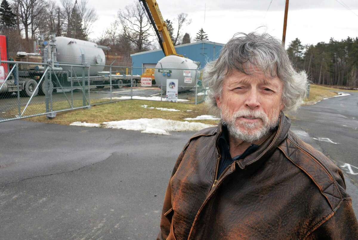 Mayor David Borge oversees the delivery of a temporary filter system at the village of Hoosick Falls water treatment plant on Tuesday. (John Carl D'Annibale / Times Union)