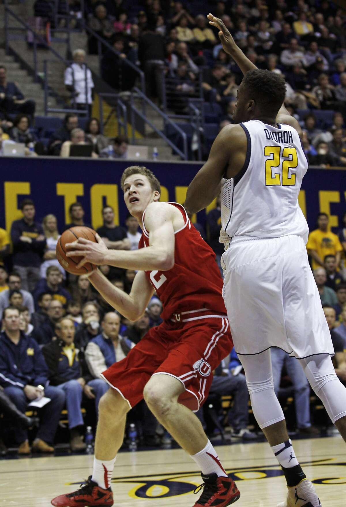 Utahs' Jakob Poeltl looks to shoot as Californias' Kingsley Okoroh defends during the first half of an NCAA basketball game, Sunday, Jan. 3, 2016, in Berkeley, Calif.