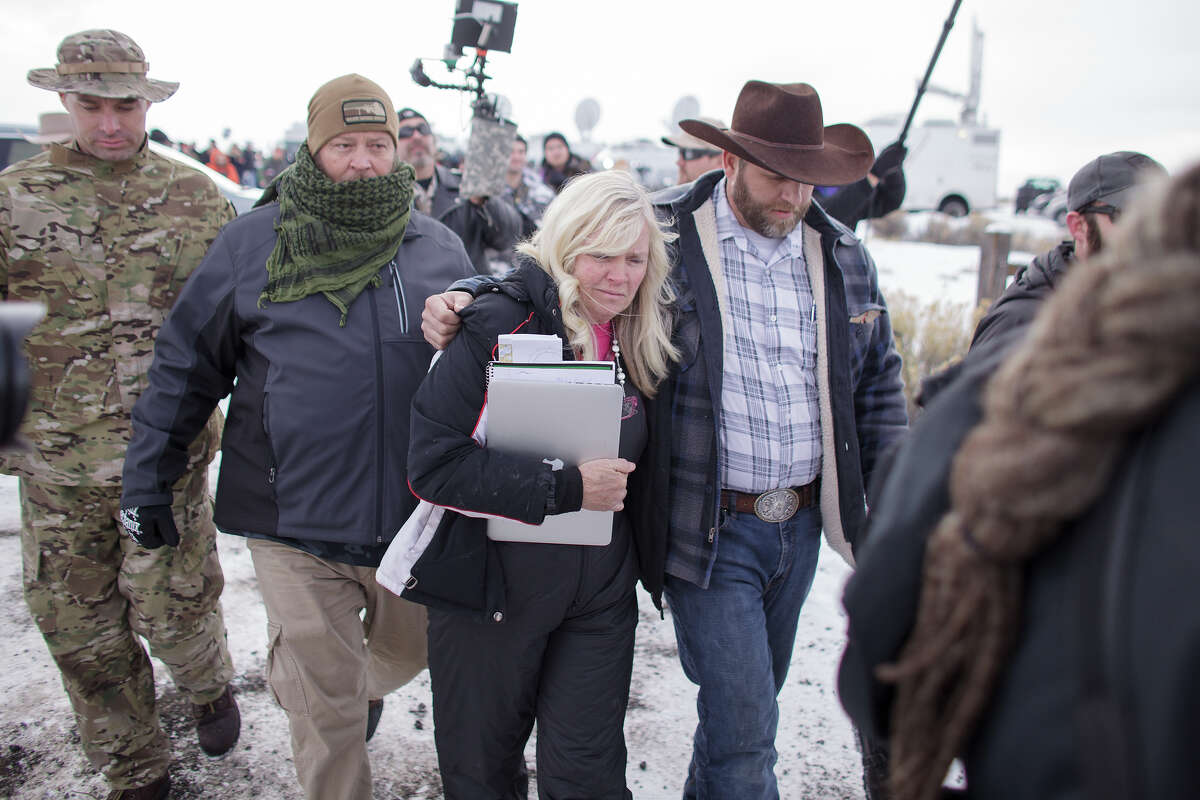 Ammon Bundy, right, leader of a group of armed anti-government protesters and Shawna Cox, were among those arrested in Oregon on Tuesday, Jan, 26, according to the FBI.