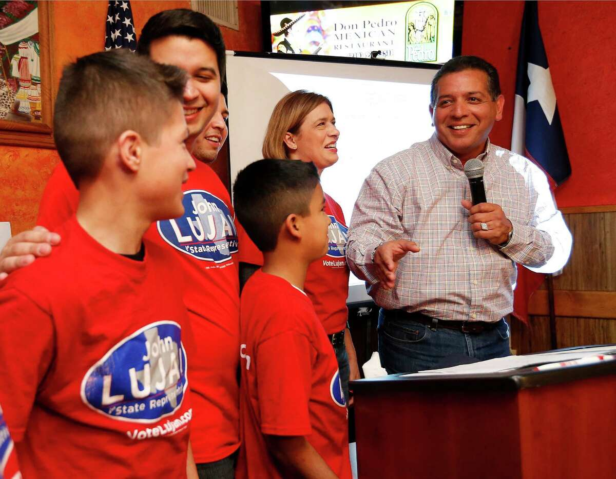 Republican candidate John Lujan (right) with his wife, Freda, and their five children speaks to supporters at his election watch party at Don Pedro Mexican Restaurant on Tuesday, Jan. 26, 2016. Lujan is running against Democrat Tomas Uresti in the special runoff election for Texas House District 118 on Tuesday, Jan. 26, 2016. The winner will replace former state rep. Joe Farias. (Kin Man Hui/San Antonio Express-News)