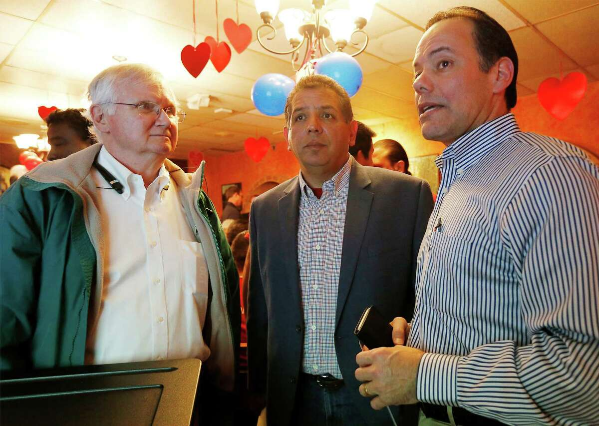 Republican candidate John Lujan (center) with Bexar County GOP Chairman Robert Stovall (right) discuss election results at Lujan's watch party on Don Pedro Mexican Restaurant on Tuesday, Jan. 26, 2016. Lujan is running against Democrat Tomas Uresti in the special runoff election for Texas House District 118. The winner will replace former state rep. Joe Farias. (Kin Man Hui/San Antonio Express-News)