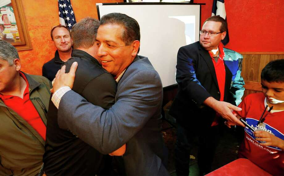 Republican candidate John Lujan (center) receives a congratulatory hug from supporters at his election watch party at Don Pedro Mexican Restaurant on Tuesday, Jan. 26, 2016. Lujan was running against Democrat Tomas Uresti in the special runoff election for Texas House District 118. Lujan, who will replace former state Rep. Joe Farias, was sworn in at the Texas Capitol on Monday. (Kin Man Hui/San Antonio Express-News) Photo: Kin Man Hui, Staff / San Antonio Express-News / ©2016 San Antonio Express-News