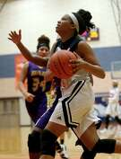 Daizha Norris (23), of George Bush, drives to the basket guarded by Dayza Mitchell (14), of Galveston Ball, during a game played at George Bush High School Tuesday, Jan. 26, 2016, in Richmond, Texas. Bush won 45-37. ( Gary Coronado / Houston Chronicle )