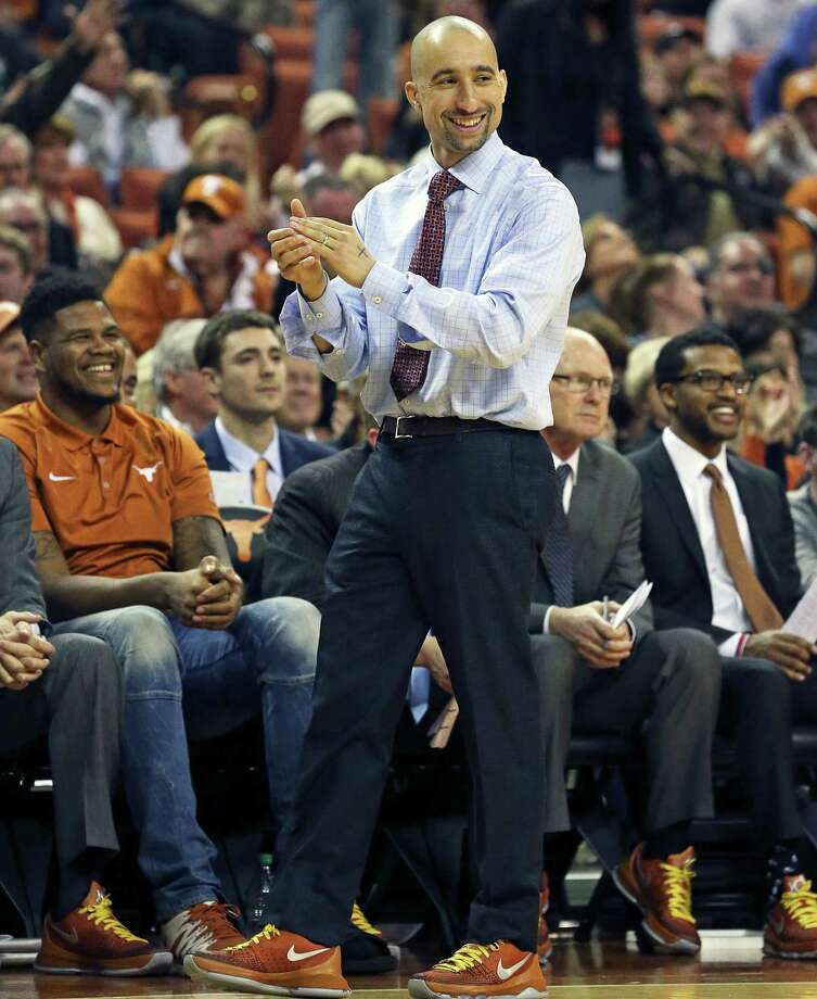Coach Shaka Smart applauds his center Prince Ibeh at the free-throw line as Texas hosts TCU at the Erwin Center in Austin on Jan. 26, 2016. Photo: Tom Reel /San Antonio Express-News / 2016 SAN ANTONIO EXPRESS-NEWS