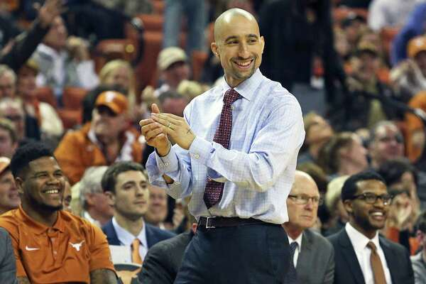 Coach Shaka Smart applauds his center Prince Ibeh at the free-throw line as Texas hosts TCU at the Erwin Center in Austin on Jan. 26, 2016.