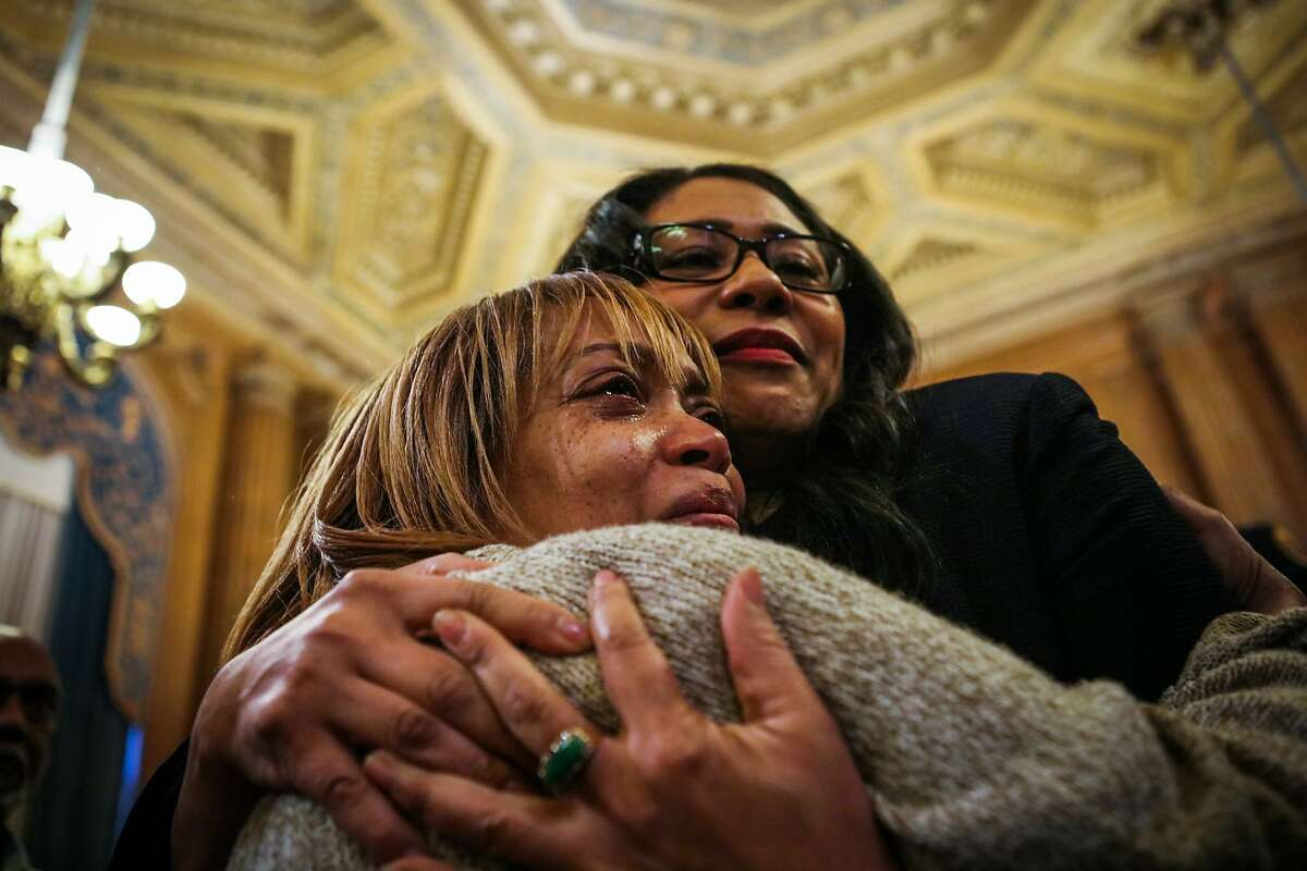 Gwen Woods (left), the mother of Mario Woods, embraces President of the Board of Supervisors London Breed, after the board unanimously approved a day of remembrance for Gwen's son, at City Hall in San Francisco, California on Tuesday, January 26, 2016. The Board of Supervisors